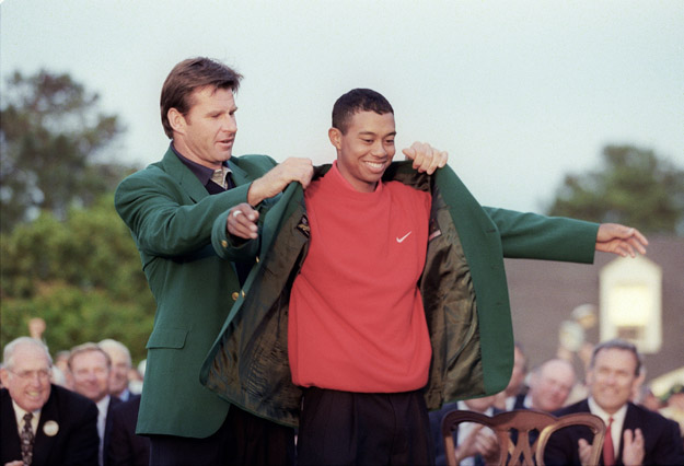 Tiger Woods (R) receives the Masters green jacket from 1996 Masters champion Nick Faldo after Woods won the 1997 Masters tournament 13 April 1997 at Augusta National Golf Club in Georgia. Woods set a new course record by shooting 18-under-par for the tournament.
