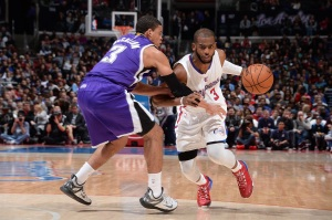 LOS ANGELES, CA - FEBRUARY 21:  Chris Paul #3 of the Los Angeles Clippers handles the ball against the Sacramento Kings during the game on February 21, 2015 at STAPLES Center in Los Angeles, California. Copyright 2015 NBAE