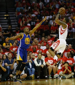 HOUSTON, TX - APRIL 24: Trevor Ariza #1 of the Houston Rockets shoots over Andre Iguodala #9 of the Golden State Warriors at Toyota Center on April 24, 2016 in Houston, Texas. NOTE TO USER: User expressly acknowledges and agrees that, by dowloading and/or using this photograph, user is consenting to the terms and conditions of the Getty Images License Agreement. (Photo by Bob Levey/Getty Images)