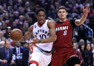 TORONTO, ON - MAY 15: DeMar DeRozan #10 of the Toronto Raptors dribbles the ball as Tyler Johnson #8 of the Miami Heat defends in Game Seven of the Eastern Conference Quarterfinals during the 2016 NBA Playoffs at the Air Canada Centre on May 15, 2016 in Toronto, Ontario, Canada. NOTE TO USER: User expressly acknowledges and agrees that, by downloading and or using this photograph, User is consenting to the terms and conditions of the Getty Images License Agreement. (Photo by Vaughn Ridley/Getty Images)