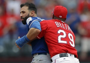 ARLINGTON, TX - MAY 15: Adrian Beltre #29 of the Texas Rangers holds Jose Bautista #19 of the Toronto Blue Jays after being punched by Rougned Odor #12 in the eighth inning at Globe Life Park in Arlington on May 15, 2016 in Arlington, Texas. (Photo by Ronald Martinez/Getty Images)