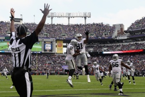 BALTIMORE, MD - OCTOBER 02:  Michael Crabtree #15 of the Oakland Raiders celebrates catching a fourth quarter touchdown pass with teammate Mychal Rivera #81 against the Baltimore Ravens at M&T Bank Stadium on October 2, 2016 in Baltimore, Maryland.  (Photo by Rob Carr/Getty Images)