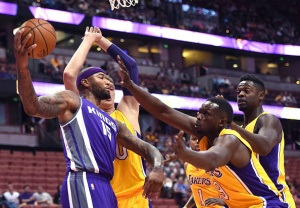 ANAHEIM, CA - OCTOBER 04:  DeMarcus Cousins #15 of the Sacramento Kings looks to pass in front of Luol Deng #9, Julius Randle #30, D'Angelo Russell #1 and Timofey Mozgov #20 of the Los Angeles Lakers during a preseason game at Honda Center on October 4, 2016 in Anaheim, California.  NOTE TO USER: User expressly acknowledges and agrees that, by downloading and or using this photograph, User is consenting to the terms and conditions of the Getty Images License Agreement.  (Photo by Harry How/Getty Images)