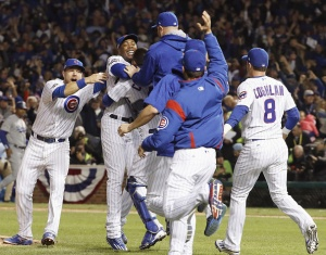 Chicago Cubs players celebrate after their 5-0 victory over the Los Angeles Dodgers in Game 6 of the National League baseball championship series in Chicago Oct. 22, 2016. The Cubs will face the Cleveland Indians in the World Series. (Photo by Kyodo News via Getty Images)