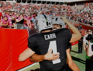 TAMPA, FL - OCTOBER 30: Quarterback Derek Carr #4 of the Oakland Raiders and wide receiver Seth Roberts #10  celebrate in the back of the end zone after connecting on the winning touchdown in overtime against the Tampa Bay Buccaneers at Raymond James Stadium on October 30, 2016 in Tampa, Florida. (Photo by Joseph Garnett Jr. /Getty Images)