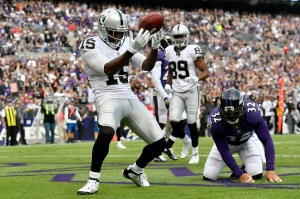BALTIMORE, MD - OCTOBER 2:  Michael Crabtree #15 of the Oakland Raiders celebrates after scoring a touchdown in the fourth quarter against the Baltimore Ravens at M&T Bank Stadium on October 2, 2016 in Baltimore, Maryland. (Photo by Larry French/Getty Images)