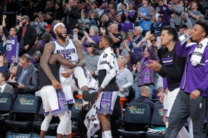 SACRAMENTO, CA - JANUARY 4: DeMarcus Cousins #15 of the Sacramento Kings celebrates with teammates during the game against the Miami Heat on January 4, 2017 at Golden 1 Center in Sacramento, California. NOTE TO USER: User expressly acknowledges and agrees that, by downloading and or using this photograph, User is consenting to the terms and conditions of the Getty Images Agreement. Mandatory Copyright Notice: Copyright 2017 NBAE (Photo by Rocky Widner/NBAE via Getty Images)