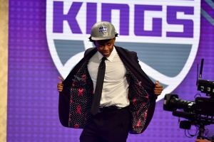 BROOKLYN, NY - JUNE 22: De'Aaron Fox shows off his jacket after being selected fifth overall by the Sacramento Kings in the 2017 NBA Draft on June 22, 2017 at Barclays Center in Brooklyn, New York. NOTE TO USER: User expressly acknowledges and agrees that, by downloading and or using this photograph, User is consenting to the terms and conditions of the Getty Images License Agreement. Mandatory Copyright Notice: Copyright 2017 NBAE