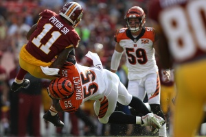 LANDOVER, MD - AUGUST 27: Wide receiver Terrelle Pryor #11 of the Washington Redskins is tackled by outside linebacker Vontaze Burfict #55 of the Cincinnati Bengals in the second quarter during a preseason game at FedExField on August 27, 2017 in Landover, Maryland.