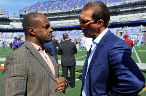 BALTIMORE, MD - SEPTEMBER 28: DeMaurice Smith (L), Executive Director of the NFLPA, speaks with Baltimore Ravens owner Steve Bisciotti (R) before a game against the Carolina Panthers at M&T Bank Stadium on September 28, 2014 in Baltimore, Maryland.