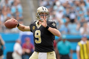 CHARLOTTE, NC - SEPTEMBER 24: Drew Brees #9 of the New Orleans Saints drops back to pass against the Carolina Panthers during their game at Bank of America Stadium on September 24, 2017 in Charlotte, North Carolina.