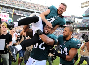 PHILADELPHIA, PA - SEPTEMBER 24: Jake Elliott #4 of the Philadelphia Eagles is picked up by teammates Najee Goode #52 and Kamu Grugier-Hill #54 after Elliott kicked the game winning field goal with 1 second left in the game against the New York Giants on September 24, 2017 at Lincoln Financial Field in Philadelphia, Pennsylvania.Elliott kicked the 61 yard field goal to defeat the New York Giants 27-24.