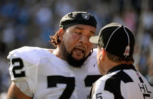SAN DIEGO, CA - NOVEMBER 16: Donald Penn #72 of the Oakland Raiders talks to the head linesman John McGrath #5 after a play in the first quater against the San Diego Chargers at Qualcomm Stadium on November 16, 2014 in San Diego, California.