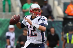 EAST RUTHERFORD, NJ - OCTOBER 15: Quarterback Tom Brady #12 of the New England Patriots throws a pass against the New York Jets during the first half of their game at MetLife Stadium on October 15, 2017 in East Rutherford, New Jersey.