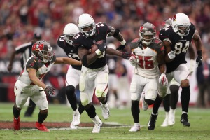 GLENDALE, AZ - OCTOBER 15: Running back Adrian Peterson #23 of the Arizona Cardinals rushes the football past cornerback Brent Grimes #24 and defensive back Robert McClain #36 of the Tampa Bay Buccaneers during the second half of the NFL game at the University of Phoenix Stadium on October 15, 2017 in Glendale, Arizona. The Cardinals defeated the Buccaneers 38-33.