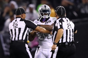 OAKLAND, CA - OCTOBER 19: Marshawn Lynch #24 of the Oakland Raiders is restrained after coming off the bench and shoving a referee during a scrum with the Kansas City Chiefs in their NFL game at Oakland-Alameda County Coliseum on October 19, 2017 in Oakland, California. Lynch was ejected for unsportsmanlike conduct.