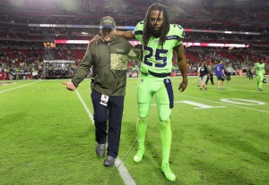 GLENDALE, AZ - NOVEMBER 09: Cornerback Richard Sherman #25 of the Seattle Seahawks is helped off the field following the NFL game against the Arizona Cardinals at the University of Phoenix Stadium on November 9, 2017 in Glendale, Arizona. The Seahawks defeated the Cardinals 22-16.
